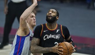 Cleveland Cavaliers' Andre Drummond (3) drives to the basket against Detroit Pistons' Mason Plumlee (24) in the first half of an NBA basketball game, Wednesday, Jan. 27, 2021, in Cleveland. (AP Photo/Tony Dejak)