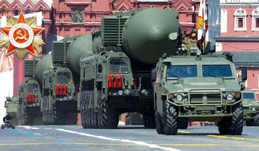 In this file photo taken on Wednesday, June 24, 2020, Russian RS-24 Yars ballistic missiles roll in Red Square during the Victory Day military parade marking the 75th anniversary of the Nazi defeat in Moscow, Russia. Russia and the United States exchanged documents Tuesday, Jan. 26, 2021, to extend the New START nuclear treaty, their last remaining arms control pact, the Kremlin said. The Kremlin readout of a phone call between U.S. President Joe Biden and Russian President Vladimir Putin said they voiced satisfaction with the move. (AP Photo/Alexander Zemlianichenko, File)
