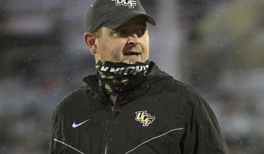 FILE - Central Florida head coach Josh Heupel watches warmups before an NCAA college football game against Tulsa in Orlando, Fla., in this Saturday, Oct. 3, 2020, file photo. Josh Heupel is leaving UCF to become the next Tennessee coach, a person with knowledge of the situation told The Associated Press on Wednesday, Jan. 27, 2021. (AP Photo/Phelan M. Ebenhack, File)