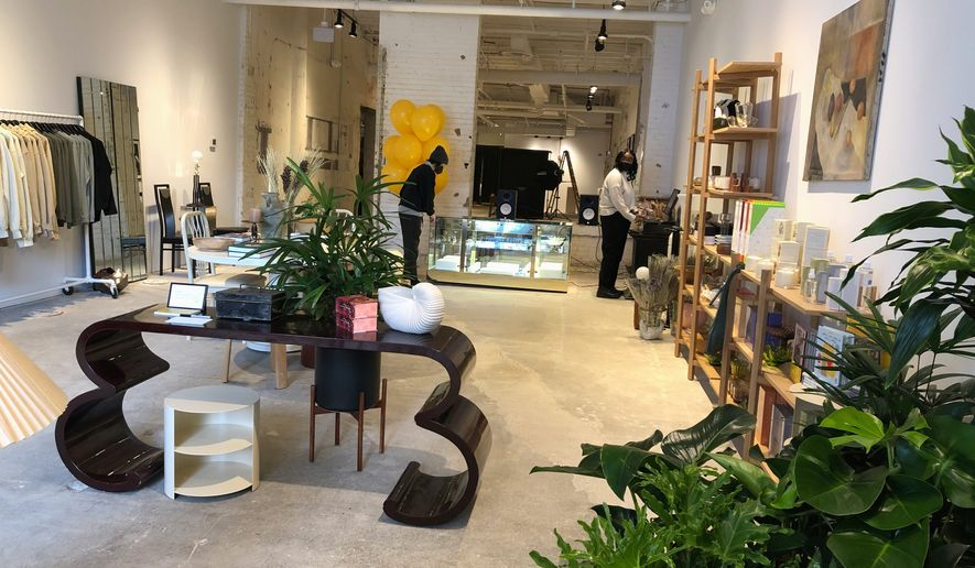 A group of 12 friends this week opened a business in the District's Union Market neighborhood called theTwelve. The business includes a retail store, an art gallery and a community lounge. (Shen Wu Tan/The Washington Times)