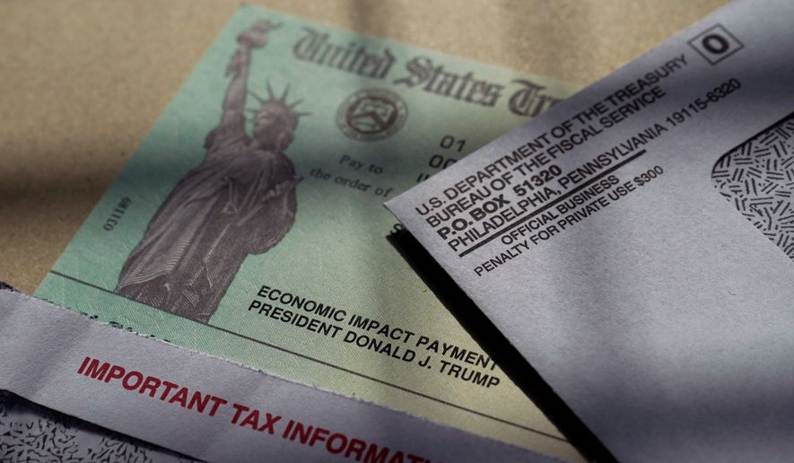 President Donald Trump's name is seen on a stimulus check issued by the IRS to help combat the adverse economic effects of the COVID-19 outbreak, in San Antonio, Thursday, Jan. 28, 2021, in San Antonio. (AP Photo/Eric Gay)