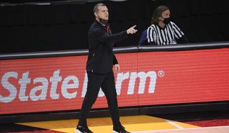 Maryland head coach Mark Turgeon gestures during the first half of an NCAA college basketball game against Wisconsin, Wednesday, Jan. 27, 2021, in College Park, Md. (AP Photo/Nick Wass)