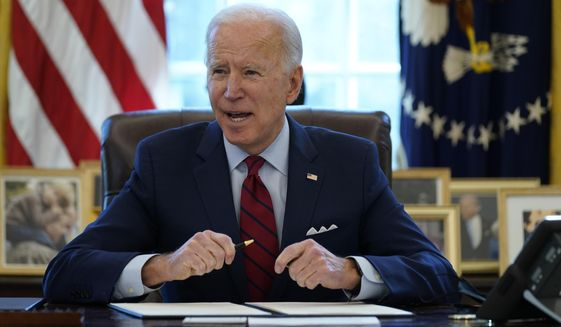 President Joe Biden signs a series of executive orders on health care, in the Oval Office of the White House, Thursday, Jan. 28, 2021, in Washington. (AP Photo/Evan Vucci)