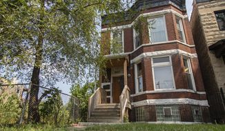 The former home of Emmett and Mamie Till at 6427 S St. Lawrence Avenue is in the West Woodlawn neighborhood of Chicago, Wednesday, Aug. 26, 2020. The Chicago home of Emmett Till, the Black teenager whose 1955 lynching galvanized the civil rights movement, has been granted landmark status. The Chicago City Council on Wednesday, Jan. 27, 2021, approved an ordinance that protects the South Side home from demolition. (Anthony Vazquez/Chicago Sun-Times via AP)