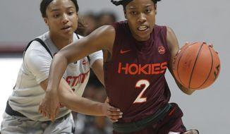North Carolina State's Kai Crutchfield fouls Virginia Tech's Aisha Sheppard (2) during overtime in an NCAA college basketball game Thursday, Jan. 28, 2021, in Blacksburg, Va. (Matt Gentry/The Roanoke Times via AP, Pool)