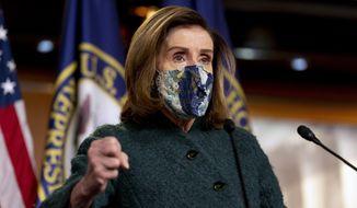 House Speaker Nancy Pelosi of Calif. speaks at a news conference on Capitol Hill in Washington, Thursday, Jan. 28, 2021. (AP Photo/Andrew Harnik)