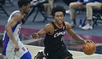 Cleveland Cavaliers' Collin Sexton, right, drives past Detroit Pistons' Josh Jackson in the first half of an NBA basketball game, Wednesday, Jan. 27, 2021, in Cleveland. (AP Photo/Tony Dejak)