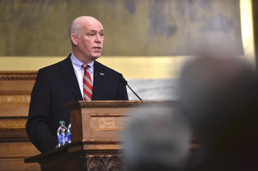 Montana Gov. Greg Gianforte addresses the Legislature on Thursday, Jan. 28, 2021, in the House Chamber of the State Capitol in Helena, Mont.  (Thom Bridge/Independent Record via AP)  **FILE**