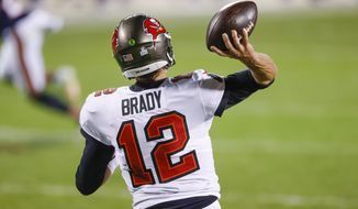 Tampa Bay Buccaneers quarterback Tom Brady (12) in action against the Chicago Bears during the first half of an NFL football game, Thursday, Oct. 8, 2020, in Chicago. (AP Photo/Kamil Krzaczynski)