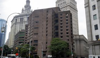 FILE - This Aug. 13, 2019, file photo shows Metropolitan Correctional Center in New York. The warden brought in to clean up the federal jail where Jeffrey Epstein killed himself abruptly stepped down after a year-long tenure marred by the rampant spread of coronavirus, inmates complaints about poor conditions, a gun smuggled into the facility, and an inmate's death. (AP Photo/Mary Altaffer, File)
