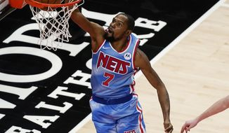 Brooklyn Nets forward Kevin Durant scores in overtime of the team's NBA basketball game against the Atlanta Hawks on Wednesday, Jan. 27, 2021, in Atlanta. (AP Photo/Brynn Anderson)