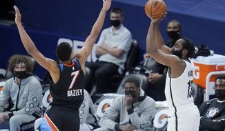 Brooklyn Nets guard James Harden (13) shoots as Oklahoma City Thunder forward Darius Bazley (7) defends in the first half of an NBA basketball game Friday, Jan. 29, 2021, in Oklahoma City. (AP Photo/Sue Ogrocki)