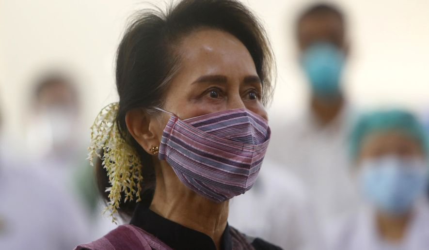 Myanmar leader Aung San Suu Kyi watches the vaccination of health workers at hospital Wednesday, Jan. 27, 2021, in Naypyitaw, Myanmar. Health workers in Myanmar on Wednesday became the country's first people to get vaccinated against COVID-19, just five days after the first vaccine supply was delivered from India. (AP Photo/Aung Shine Oo)