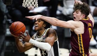 Purdue guard Jaden Ivey (23) is fouled by Minnesota center Liam Robbins (0) during the second half of an NCAA college basketball game in West Lafayette, Ind., Saturday, Jan. 30, 2021. (AP Photo/Michael Conroy)