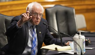 Sen. Bernie Sanders, D-Vt., questions former Gov. Jennifer Granholm, D-Mich., as she testifies before the Senate Energy and Natural Resources Committee during a hearing to examine her nomination to be Secretary of Energy, Wednesday, Jan. 27, 2021 on Capitol Hill in Washington. (Graeme Jennings/Pool via AP)