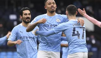 Manchester City's Gabriel Jesus, center, celebrates after scoring his side's opening goal during the English Premier League match between Manchester City and Sheffield United at the the City of Manchester Stadium in Manchester, England, Saturday, Jan. 30, 2021. (Michael Regan/Pool via AP)