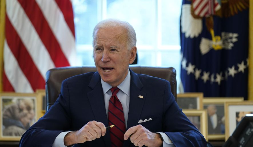 President Joe Biden signs a series of executive orders on health care, in the Oval Office of the White House, Thursday, Jan. 28, 2021, in Washington. The Democratic push to raise the minimum wage to $15 an hour has emerged as an early flashpoint in the push for a $1.9 trillion COVID relief package, providing an early test of President Joe Biden's ability to bridge Washington's partisan divide in pursuing his first major legislative victory. (AP Photo/Evan Vucci) ** FILE **