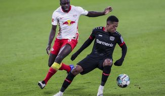 Leipzig's Dayot Upamecano, left, and Leverkusen's Leon Bailey challenge for the ball during the German Bundesliga soccer match between RB Leipzig and Bayer 04 Leverkusen in Leipzig, Germany, Saturday, Jan. 30, 2021. (AP Photo/Michael Sohn)