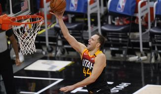 Utah Jazz forward Bojan Bogdanovic lays the ball up during the second half of the team's NBA basketball game against the Dallas Mavericks on Friday, Jan. 29, 2021, in Salt Lake City. (AP Photo/Rick Bowmer)