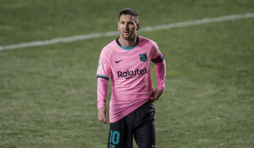 Barcelona's Lionel Messi during a Spanish Copa del Rey round of 16 soccer match between Rayo Vallecano and FC Barcelona at the Vallecas stadium in Madrid, Spain, Wednesday, Jan. 27, 2021. (AP Photo/Manu Fernandez) **FILE**