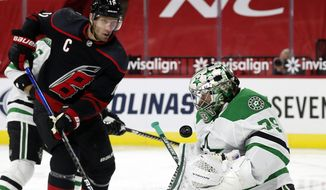 Carolina Hurricanes' Jordan Staal (11) has his shot blocked by Dallas Stars goaltender Anton Khudobin (35) during the second period of an NHL hockey game in Raleigh, N.C., Saturday, Jan. 30, 2021. (AP Photo/Karl B DeBlaker)