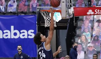Villanova forward Jeremiah Robinson-Earl scores a goal during the second half of an NCAA college basketball game against Seton Hall, Saturday, Jan. 30, 2021, in Newark, N.J. (AP Photo/Mary Altaffer)
