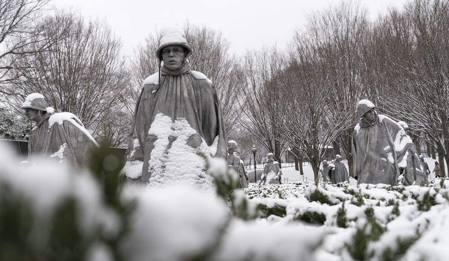 Snow blankets the soldiers at the Korean War Veterans Memorial, Sunday, Jan. 31, 2021, in Washington. (AP Photo/Alex Brandon)