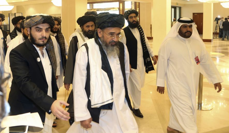 A Taliban delegation arrive to attend the opening session of the peace talks between the Afghan government and the Taliban in Doha, Qatar. (AP Photo/ Hussein Sayed, File)