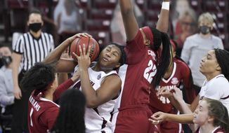South Carolina forward Aliyah Boston (4) battles for the ball against Alabama forward Ariyah Copeland (22) and Megan Abrams (1) during the first half of an NCAA college basketball game Sunday, Jan. 31, 2021, in Columbia, S.C. (AP Photo/Sean Rayford)