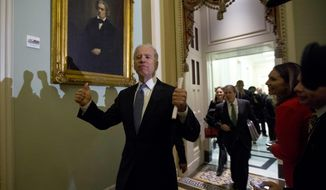 FILE - In this Dec. 31, 2012, file photo Vice President Joe Biden gives two thumbs up following a Senate Democratic caucus meeting about the fiscal cliff on Capitol Hill in Washington. (AP Photo/Alex Brandon, File)