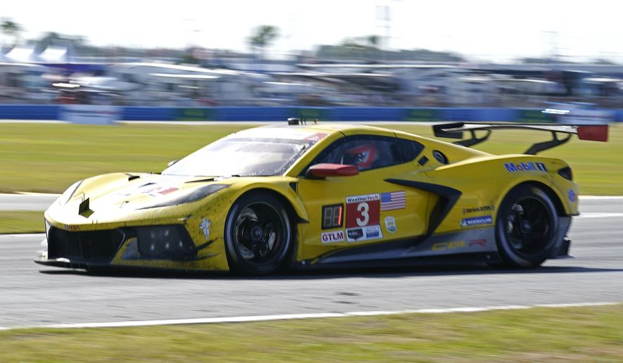 Jordan Taylor drives the Corvette C8.R through the infield course during the auto race at Daytona International Speedway, Sunday, Jan. 31, 2021, in Daytona Beach, Fla. (AP Photo/John Raoux)