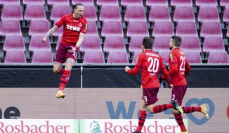Cologne's Marius Wolf, celebrates his side's opening goal during a German Bundesliga soccer match between 1. FC Cologne and Arminia Bielefeld in Cologne, Germany, Sunday, Jan.31, 2021. (Rolf Vennenbernd/dpa via AP)