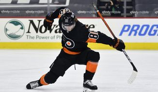 Philadelphia Flyers' Joel Farabee celebrates after scoring a goal past New York Islanders goaltender Ilya Sorokin during the first period of an NHL hockey game, Sunday, Jan. 31, 2021, in Philadelphia. (AP Photo/Derik Hamilton)