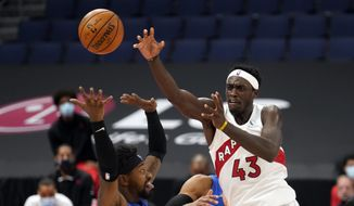 Toronto Raptors forward Pascal Siakam (43) passes the ball over Orlando Magic guard Terrence Ross (31) during the second half of an NBA basketball game Sunday, Jan. 31, 2021, in Tampa, Fla. (AP Photo/Chris O'Meara)  **FILE**