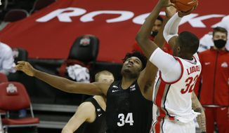 Ohio State's E.J. Liddell, right, shoots over Michigan State's Julius Marble during the second half of an NCAA college basketball game Sunday, Jan. 31, 2021, in Columbus, Ohio.  (AP Photo/Jay LaPrete)