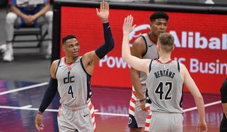 Washington Wizards guard Russell Westbrook (4) reacts with forward Davis Bertans (42) after scoring and basket and was fouled during the second half of an NBA basketball game against the Brooklyn Nets, Sunday, Jan. 31, 2021, in Washington. (AP Photo/Nick Wass)