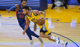 Golden State Warriors guard Stephen Curry (30) drives toward the basket against Detroit Pistons guard Derrick Rose (25) during the first half of an NBA basketball game in San Francisco, Saturday, Jan. 30, 2021. (AP Photo/Jeff Chiu)