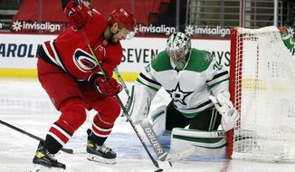 Carolina Hurricanes' Nino Niederreiter (21) works the puck in front of Dallas Stars goaltender Anton Khudobin (35) during the second period of an NHL hockey game in Raleigh, N.C., Sunday, Jan. 31, 2021. (AP Photo/Karl B DeBlaker)
