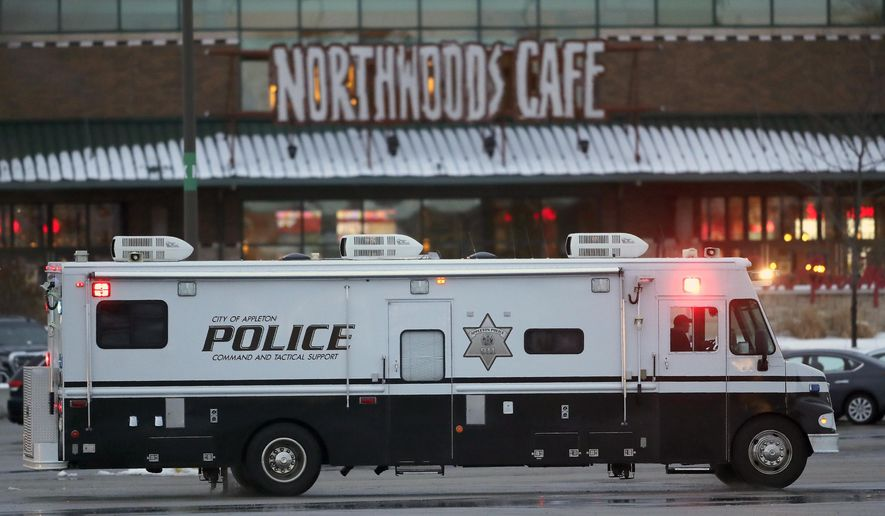Authorities respond to the Fox River Mall in Grand Chute, Wis., after two people were shot in the mall Sunday, Jan. 31, 2021. (William Glasheen/The Post-Crescent via AP)