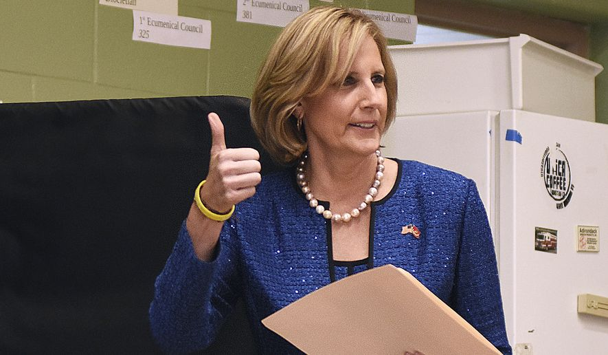 In this Nov. 6, 2018, file photo, Republican Congresswoman Claudia Tenney signals she successfully cast her ballot after voting at St. George's Church in New Hartford, N.Y.  Tenney appeared on the verge of recapturing her old seat in Congress as election officials wrapped up counting ballots Monday, Feb. 1, 2021, in the nation's last undecided U.S. House race. (AP Photo/Heather Ainsworth, File)