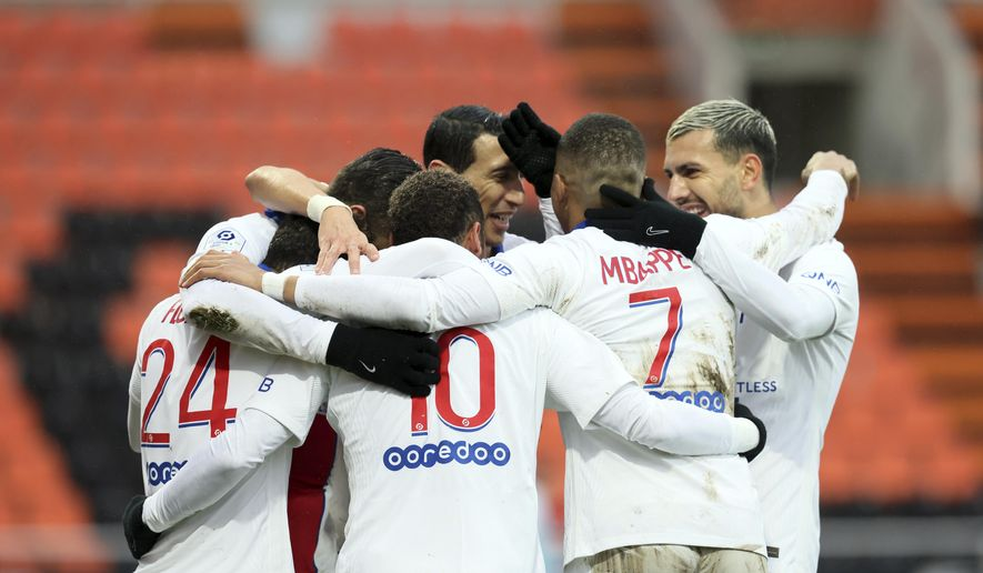 PSG's players celebrate after Neymar scored his side's second goal during the French League One soccer match between FC Lorient and Paris Saint-Germain at the Moustoir stadium in Lorient, western France, Sunday, Jan. 31, 2021. (AP Photo/David Vincent)