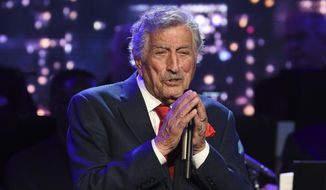 """Singer Tony Bennett performs at the Statue of Liberty Museum opening celebration in New York on May 15, 2019. Bennett has been diagnosed with Alzheimer's disease but the diagnosis hasn't quieted his legendary voice. The singer's wife and son reveal in the latest edition of AARP The Magazine that Bennett was first diagnosed in 2016. The magazine says he endures """"increasingly rarer moments of clarity and awareness."""" (Photo by Evan Agostini/Invision/AP, File)"""