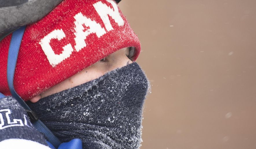 A man wears a face covering on a cold winter day in Montreal, Saturday, January 30, 2021, as the COVID-19 pandemic continues in Canada and around the world.  (Graham Hughes/The Canadian Press via AP)