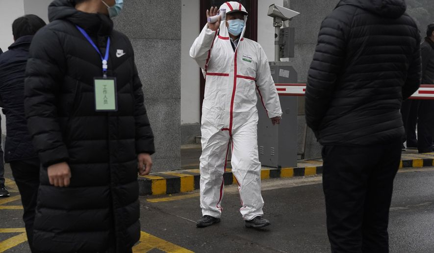Marion Koopmans of a World Health Organization team arrives at the Hubei Center for Disease Control and Prevention in Wuhan in central China's Hubei province Monday, Feb. 1, 2021. The WHO mission team investigating the origins of the coronavirus pandemic in Wuhan. (AP Photo/Ng Han Guan)