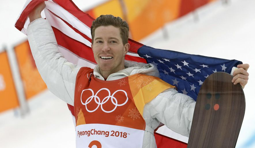 FILE - In this Feb. 14, 2018, file photo, gold medal winner Shaun White celebrates after the men's halfpipe finals at the 2018 Winter Olympics in Pyeongchang, South Korea. With the mountains closed and the halfpipes shuttered during a pandemic that turned the world and its sports upside down, White put double-corks on hold and saved his most intense workouts for his mind. (AP Photo/Lee Jin-man, File)