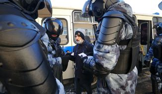 Police officers detain a man during protest after Alexei Navalny was sentenced to a jail term, in Moscow, Russia, Tuesday, Feb. 2, 2021. A Moscow court has ordered Russian opposition leader Alexei Navalny to prison for more than 2 1/2 years on charges that he violated the terms of his probation while he was recuperating in Germany from nerve-agent poisoning. Navalny, who is the most prominent critic of President Vladimir Putin, had earlier denounced the proceedings as a vain attempt by the Kremlin to scare millions of Russians into submission. (AP Photo/Alexander Zemlianichenko)