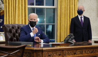 President Joe Biden gestures as he delivers remarks on immigration, in the Oval Office of the White House, Tuesday, Feb. 2, 2021, in Washington. Secretary of Homeland Security Alejandro Mayorkas listens at right. (AP Photo/Evan Vucci)