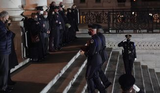An honor guard carries an urn with the cremated remains of U.S. Capitol Police officer Brian Sicknick and a folded American flag up the steps of the U.S Capitol to lie in honor in the Rotunda, Tuesday, Feb. 2, 2021, in Washington, as Senate Majority Leader Chuck Schumer of N.Y., and House Speaker Nancy Pelosi of Calif., left, and the family, right,. watch. (AP Photo/Alex Brandon, Pool)