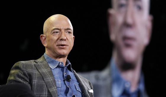 """In this June 6, 2019, file photo Amazon CEO Jeff Bezos speaks at the the Amazon re:MARS convention in Las Vegas. Washington state's richest residents, including Bezos and Bill Gates, would pay a wealth tax on certain financial assets worth more than $1 billion under a proposed bill whose sponsor says she is seeking a fair and equitable tax code. Under the bill, starting Jan. 1, 2022, for taxes due in 2023, a 1% tax would be levied on """"extraordinary"""" assets ranging from cash, publicly traded options, futures contracts, and stocks and bonds. (AP Photo/John Locher, File)"""