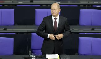 File - In this Tuesday, Sept. 29, 2020 file photo German Finance Minister Olaf Scholz arrives for a budget debate as part of a meeting of the German federal parliament, Bundestag, at the Reichstag building in Berlin, Germany. Germany's finance minister has unveiled plans to strengthen the country's financial supervisory authority following the accounting scandal at payment systems provider Wirecard.(AP Photo/Michael Sohn, file)